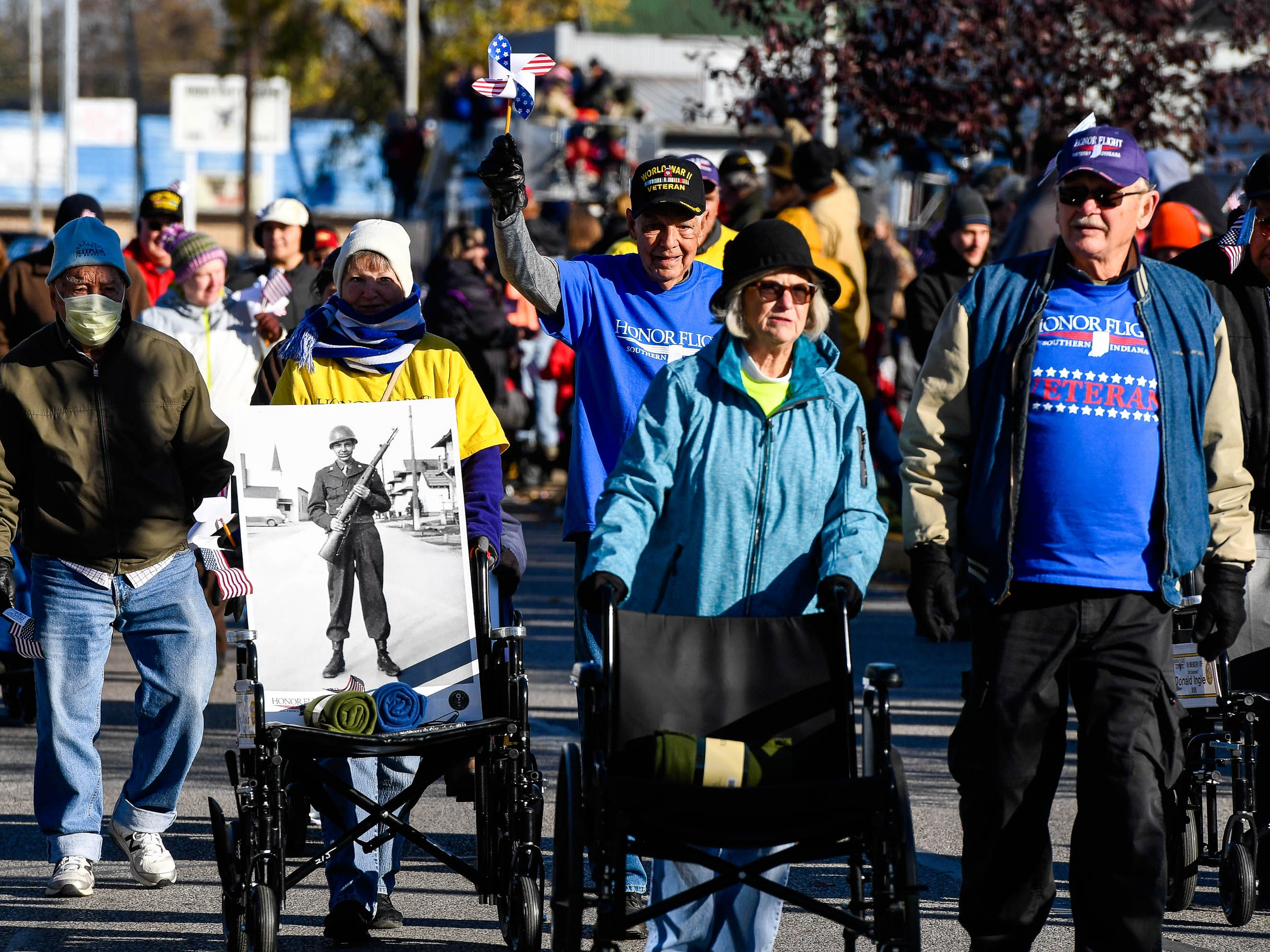 Honor flight veterans at the annual Four Freedoms Veterans Parade on Evansville's West Franklin Street Saturday, November 10, 2018.