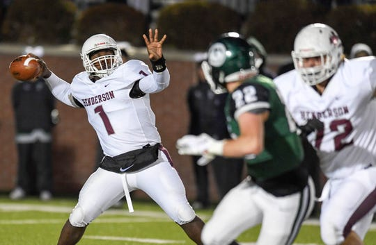 Henderson quarterback Skip Patterson (1) drops back to pass as the Henderson County Colonels play the Trinity Shamrocks in the second round of the Class 6-A football playoffs at Marshall Stadium in Louisville Friday, November 9, 2018.