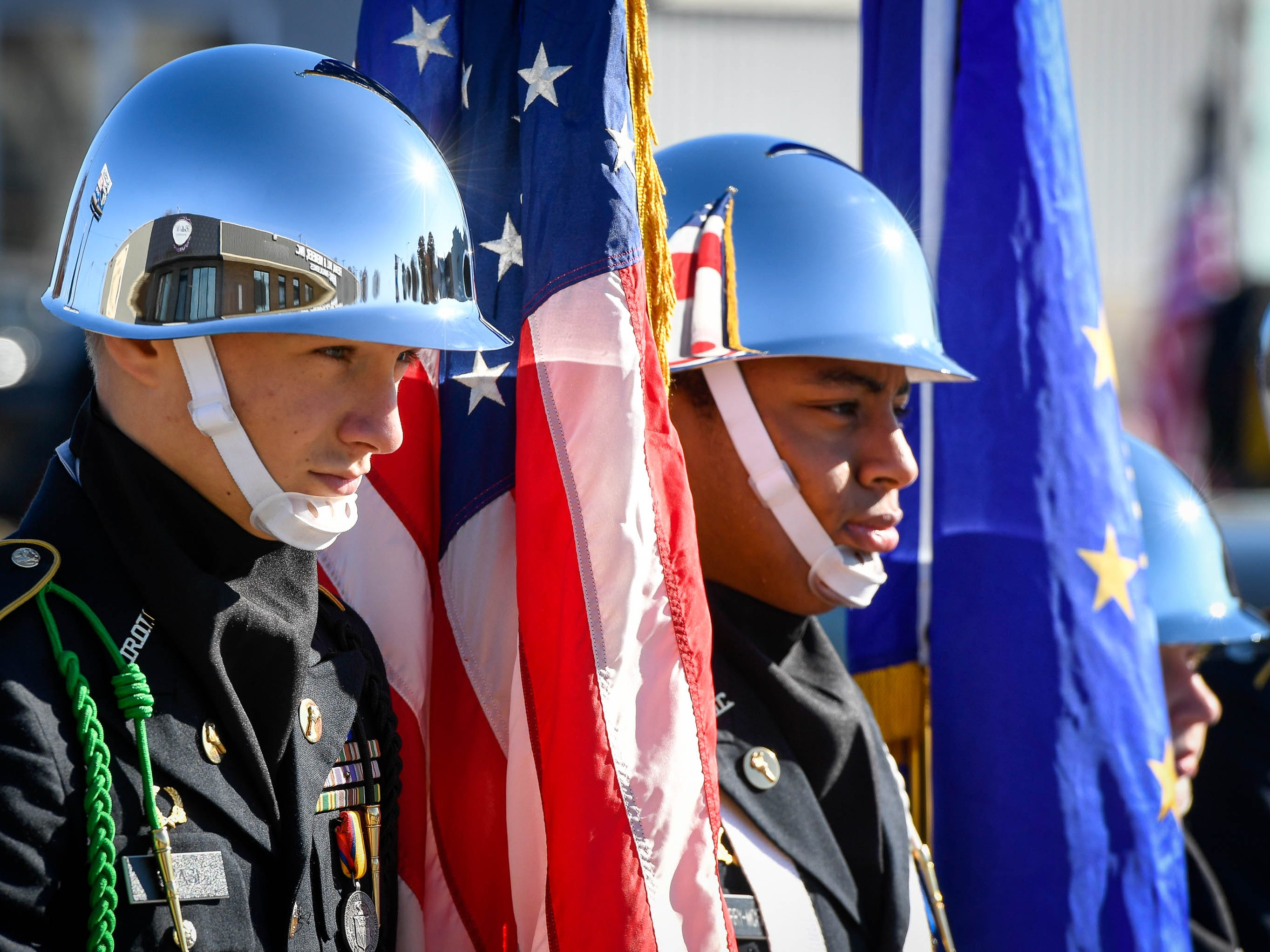 Color Guard members Shiloh Stasi, from North High School and Braxxton Murray, Harrison High School wait for the start of the annual Four Freedoms Veterans Parade on Evansville's West Franklin Street Saturday, November 10, 2018.