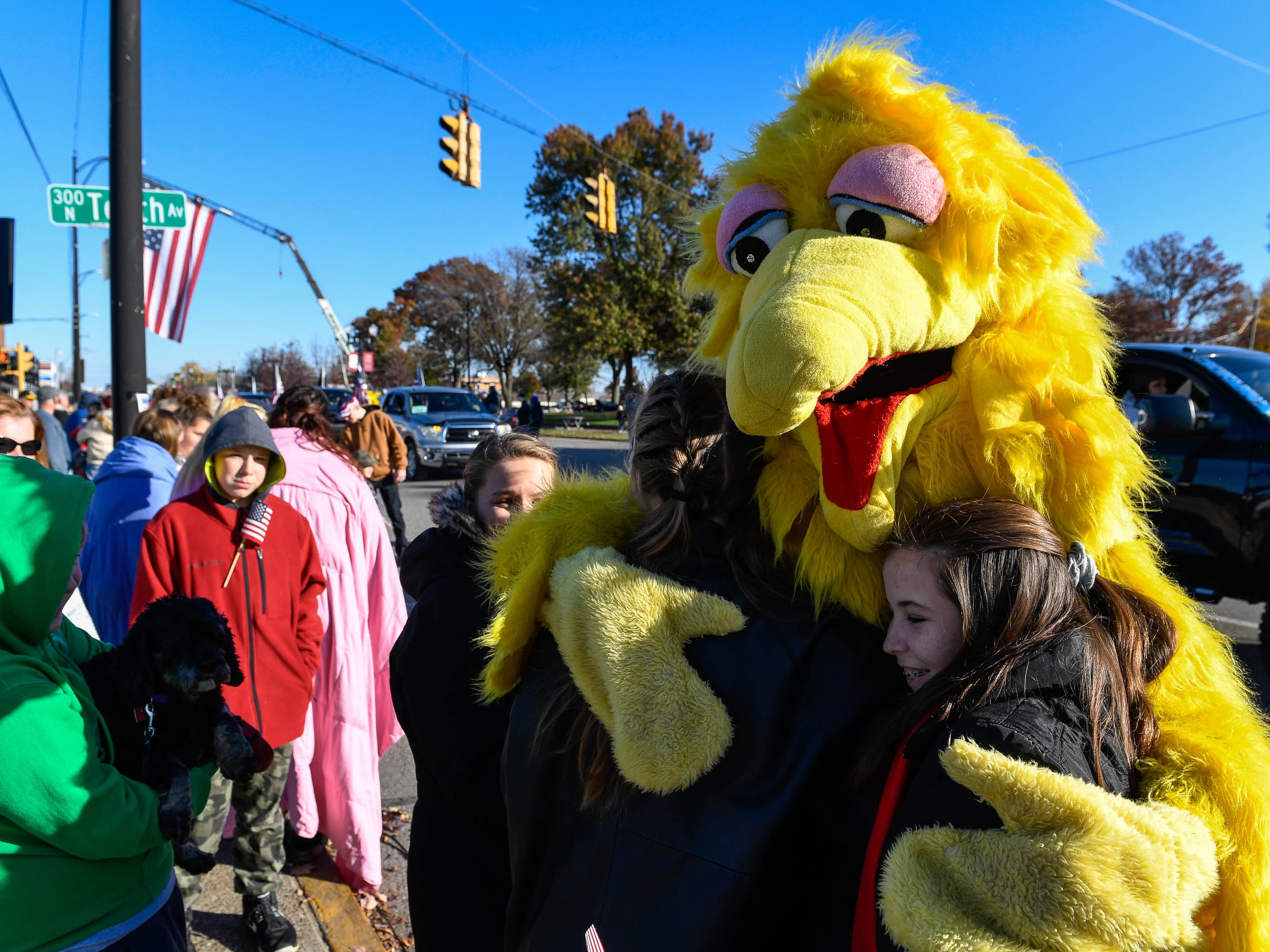 The West Side Nut Club Big Bird gathers hugs at the annual Four Freedoms Veterans Parade on Evansville's West Franklin Street Saturday, November 10, 2018.