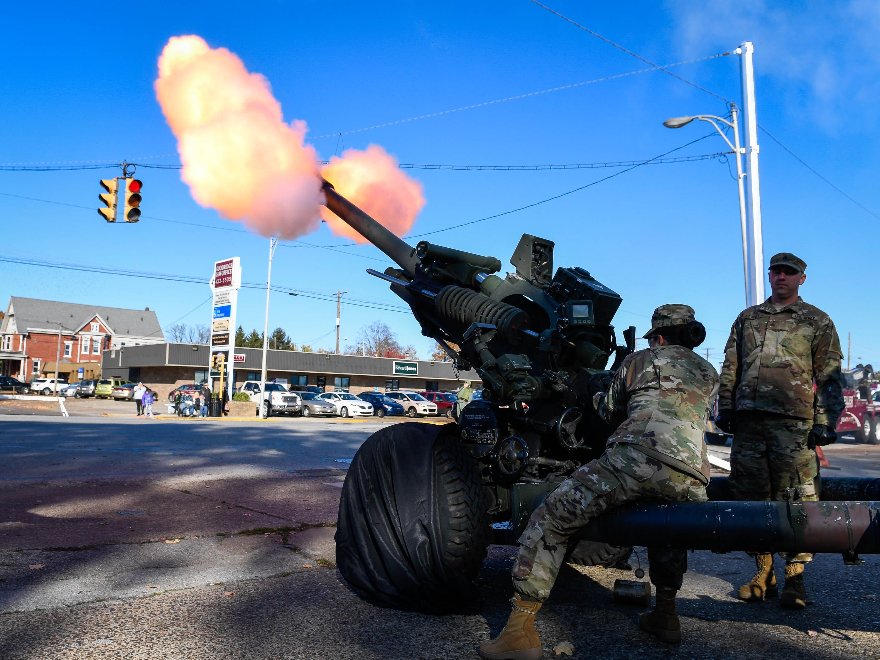 Indiana National Guard members fire a cannon to start the annual Four Freedoms Veterans Parade on Evansville's West Franklin Street Saturday, November 10, 2018.