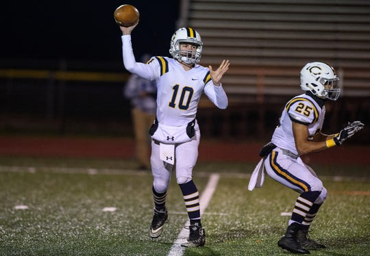 Castle's Cameron Justus throws a pass as Noah Taylor sets up to block during a regional final football game against Columbus East at Columbus East High School in Columbus, Ind., Friday, Nov. 9, 2018. Mike Wolanin | The Republic