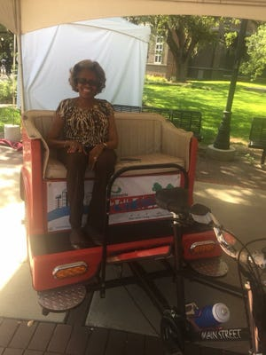 FSU faculty member Eva Killings enjoys a ride in a pedicab.