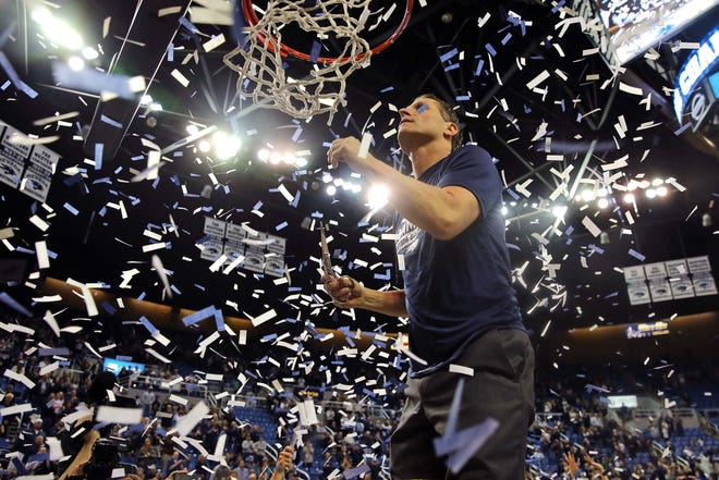 Nevada basketball coach Eric Musselman steps up to cut the net down after his team defeated CSU in a Feb. 25, 2018, game at Lawlor Events Center in Reno, Nev., to clinch a second straight Mountain West regular-season title.