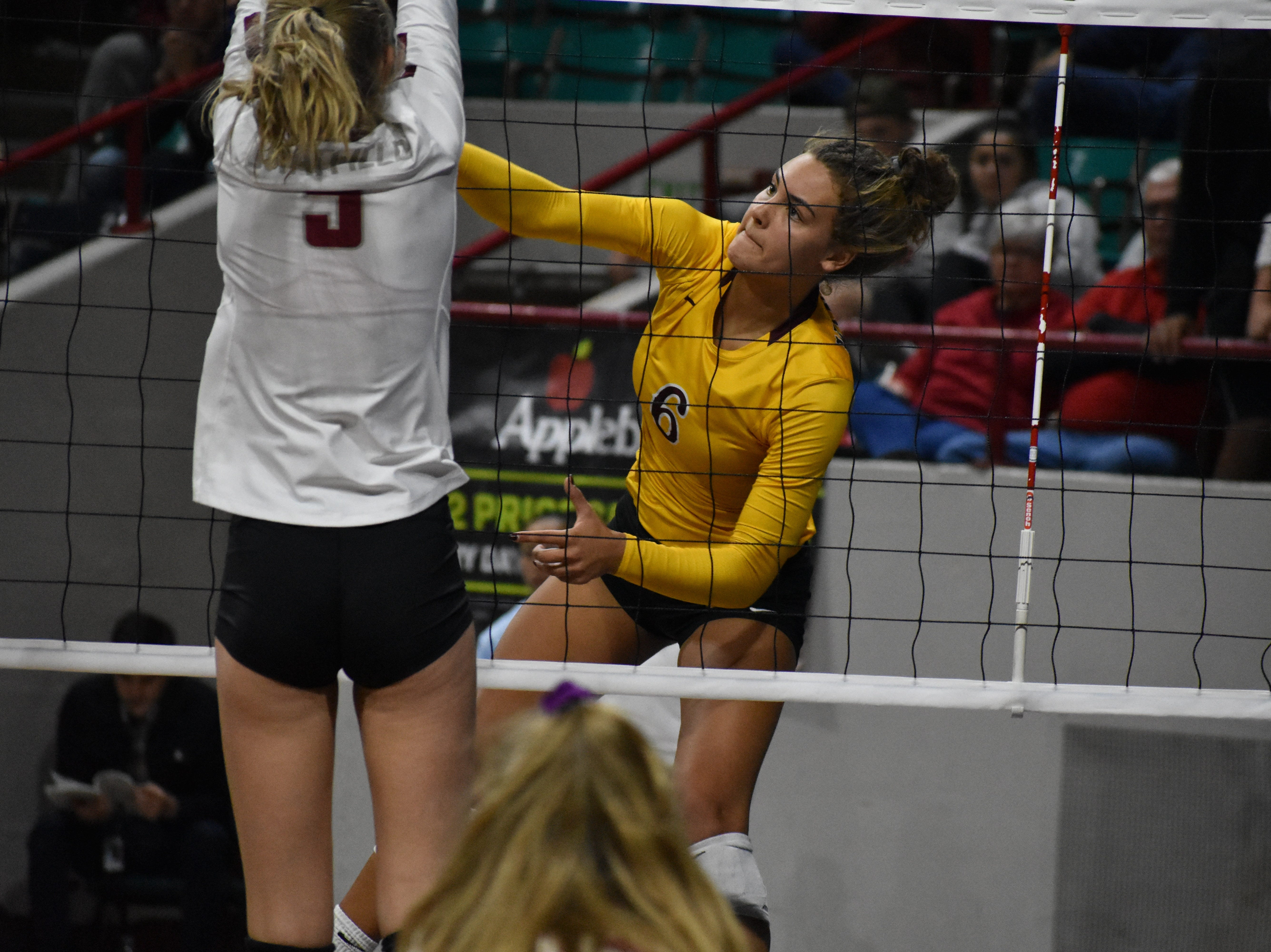 Windsor's Ally Kennis hammers home a point during Friday's Class 5A state volleyball tournament at the Denver Coliseum.