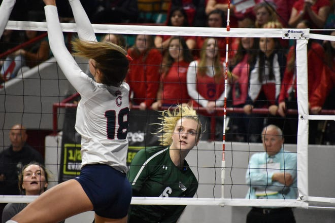 Fossil Ridge's Riley Zuhn gets a kill during the SaberCats 3-1 loss to Chaparral during Friday's Class 5A state volleyball tournament at the Denver Coliseum.