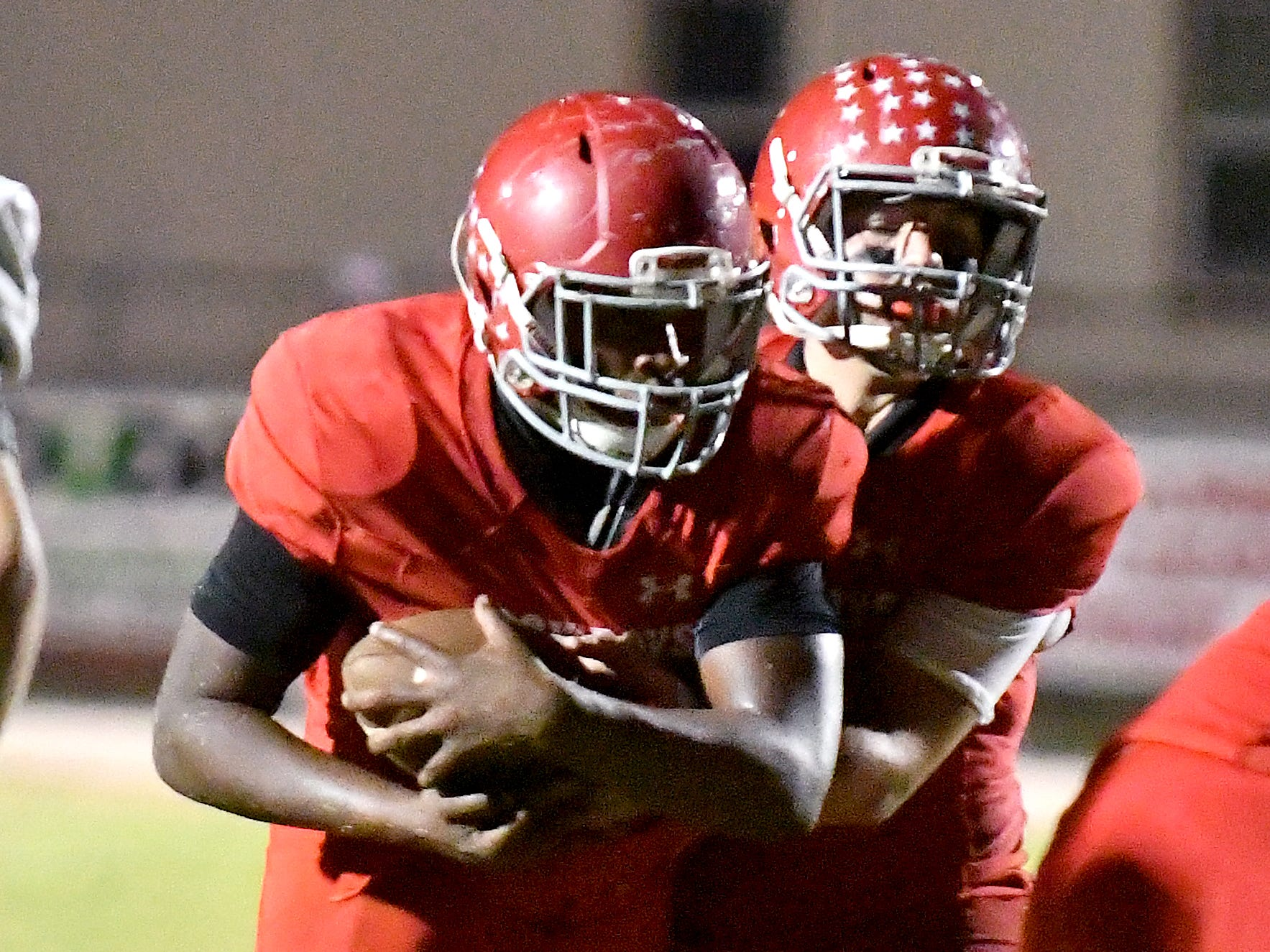 LaBelle quarterback Bryce Hall hands of to Maynard Blackmon during LaBelle's win over Lake Placid 14-13 in a Class 4A regional quarterfinal on Friday.