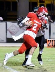 LaBelle High School's Enrique Hernandez runs the ball during the Cowboys' game with Lake Placid High Schoolon Friday, Nov. 9.