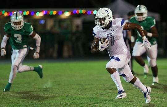 Barron Collier High School's Jayden Rolle scores a touchdown against Fort Myers on Friday at Sam Sirianni Field in Fort Myers. Fort Myers beat Barron 42-14.