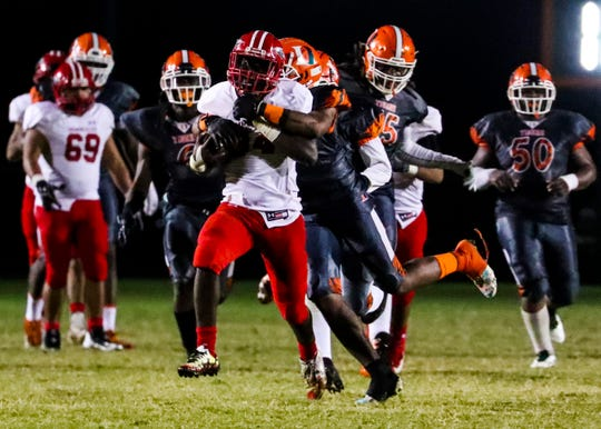 Action from the Immokalee at Dunbar high school football regional quarterfinal game.