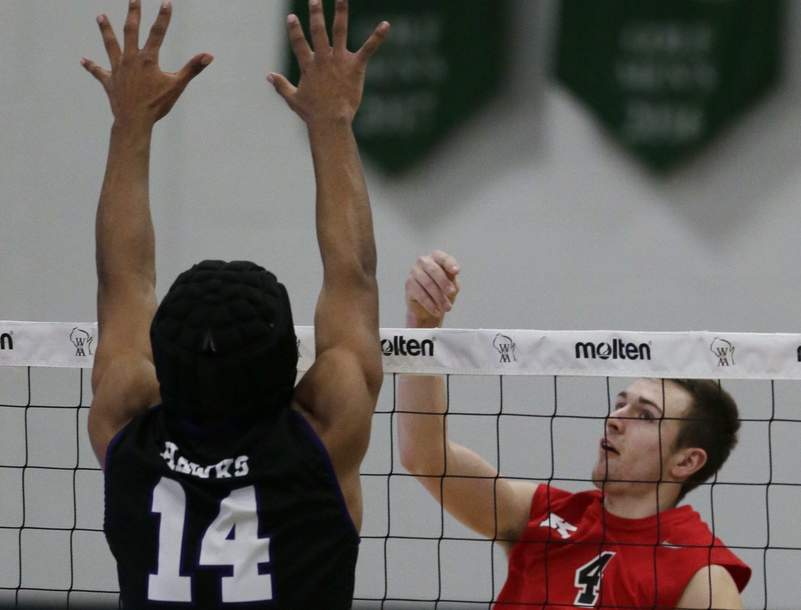 Kimberly's Trey Anderson bumps the ball over the net.  Kimberly Papermakers played Kenosha Indian Trail Hawks in Division 1 WIAA boys volleyball playoff semi-final, Saturday, November 10, 2018 at Wisconsin Lutheran College in Milwaukee, Wis. Joe Sienkiewicz/USA Today NETWORK-Wisconsin