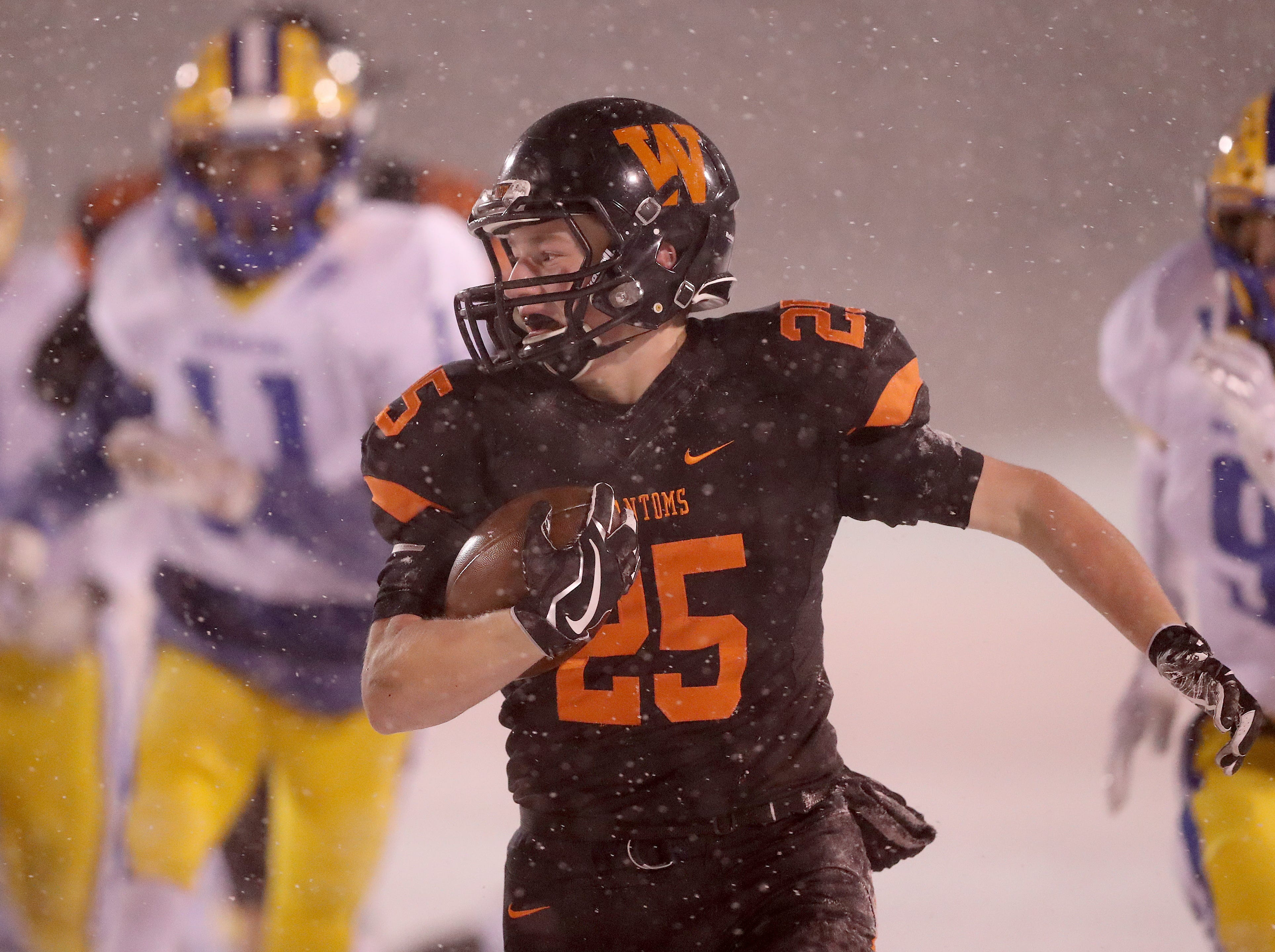 West De Pere's Kaden Kosobucki runs through the defense against Rice Lake in the Division 3 Level 4  WIAA playoffs Friday, November 9, 2018 at DC Everest High School in Weston, Wis.