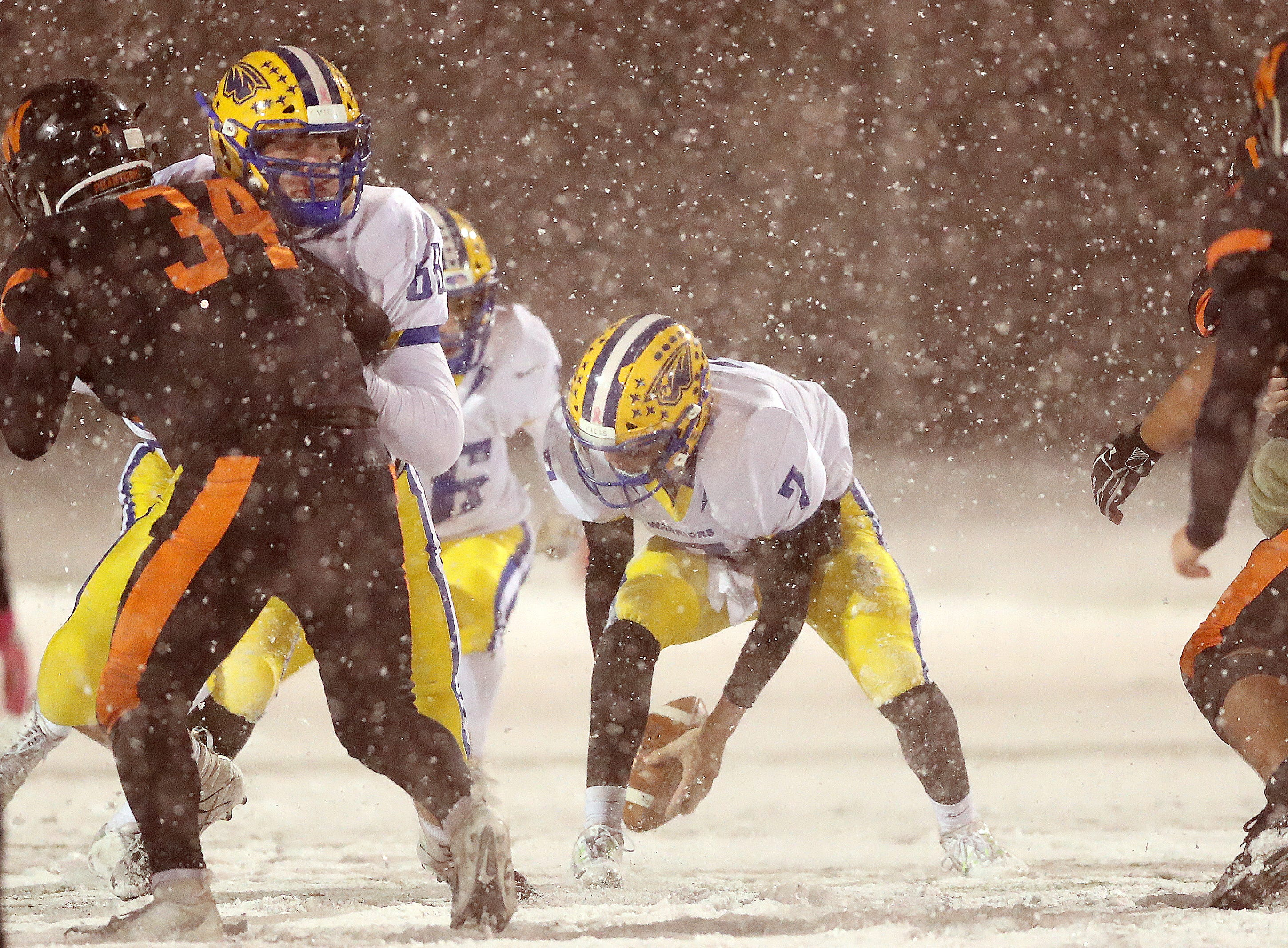 West De Pere's defense closes in on Rice Lake's Peyton Buckley as he fumbles in the heavy snow in the Division 3 Level 4  WIAA playoffs Friday, November 9, 2018 at DC Everest in Weston, Wis.