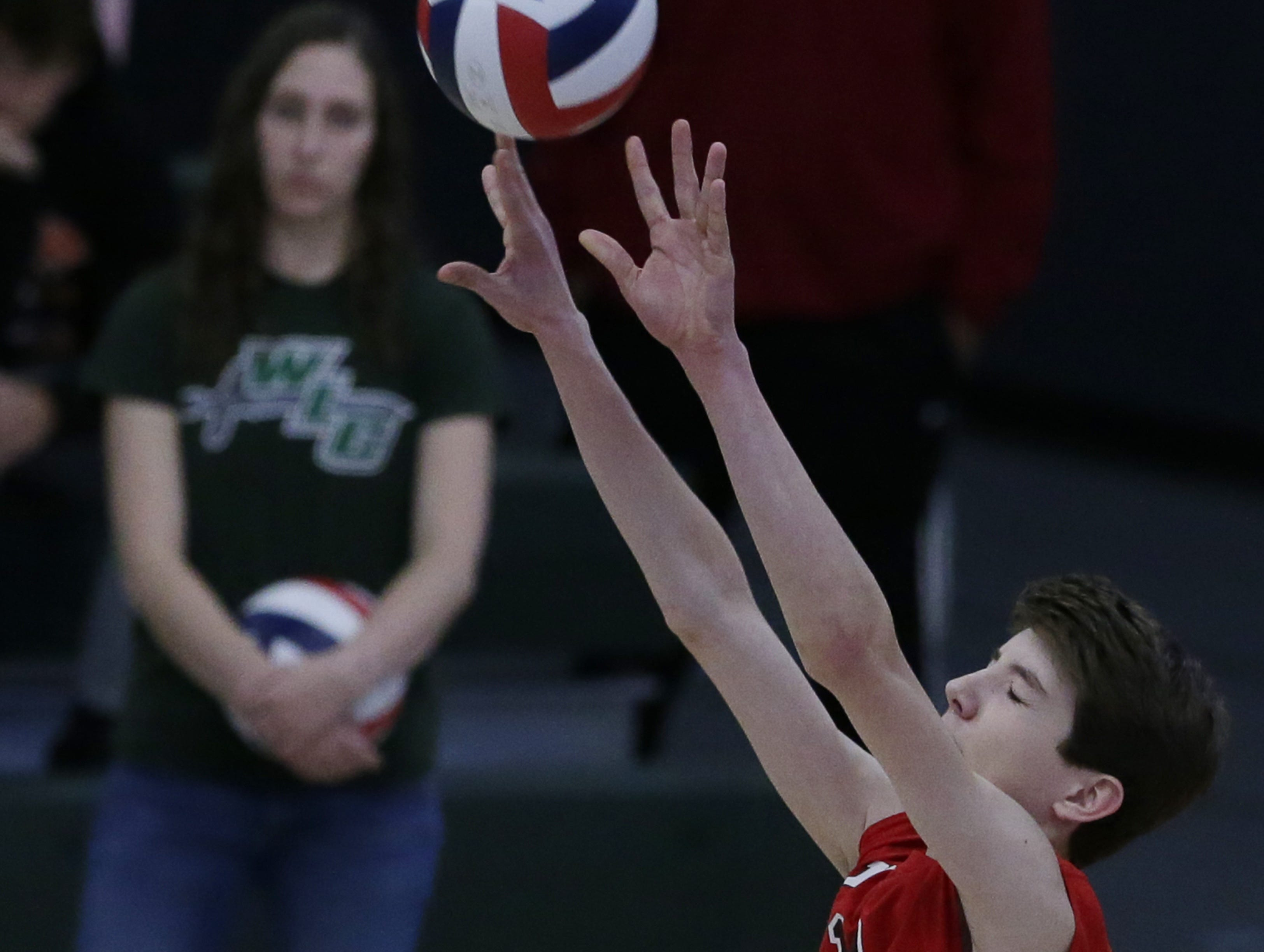 Kimberly's Parker Hietpas sets the ball after a hit during their game.  Kimberly Papermakers played Kenosha Indian Trail Hawks in Division 1 WIAA boys volleyball playoff semi-final, Saturday, November 10, 2018 at Wisconsin Lutheran College in Milwaukee, Wis. Joe Sienkiewicz/USA Today NETWORK-Wisconsin