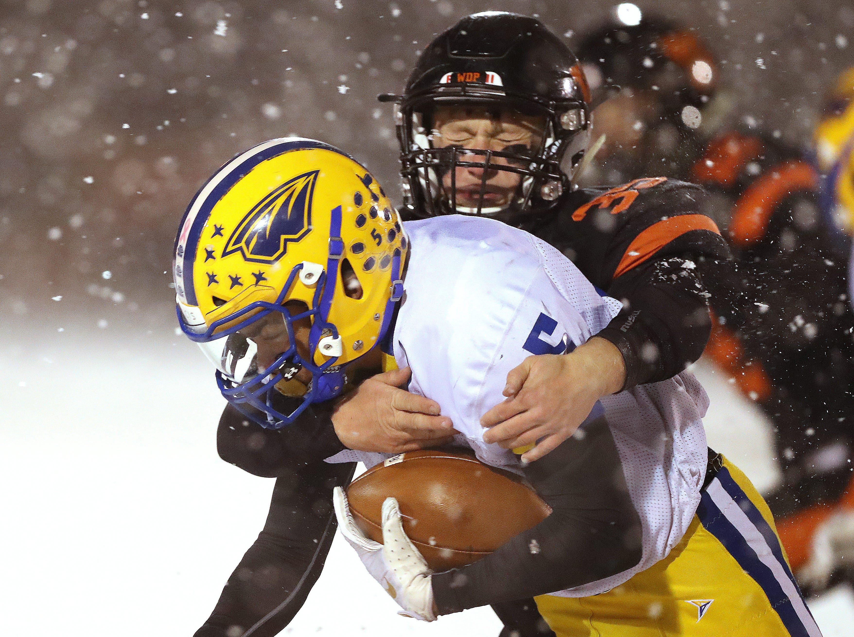 West De Pere's Alex Spitzer tackles DeAirus Clerveaux against Rice Lake in the Division 3 Level 4  WIAA playoffs Friday, November 9, 2018 at DC Everest in Weston, Wis.