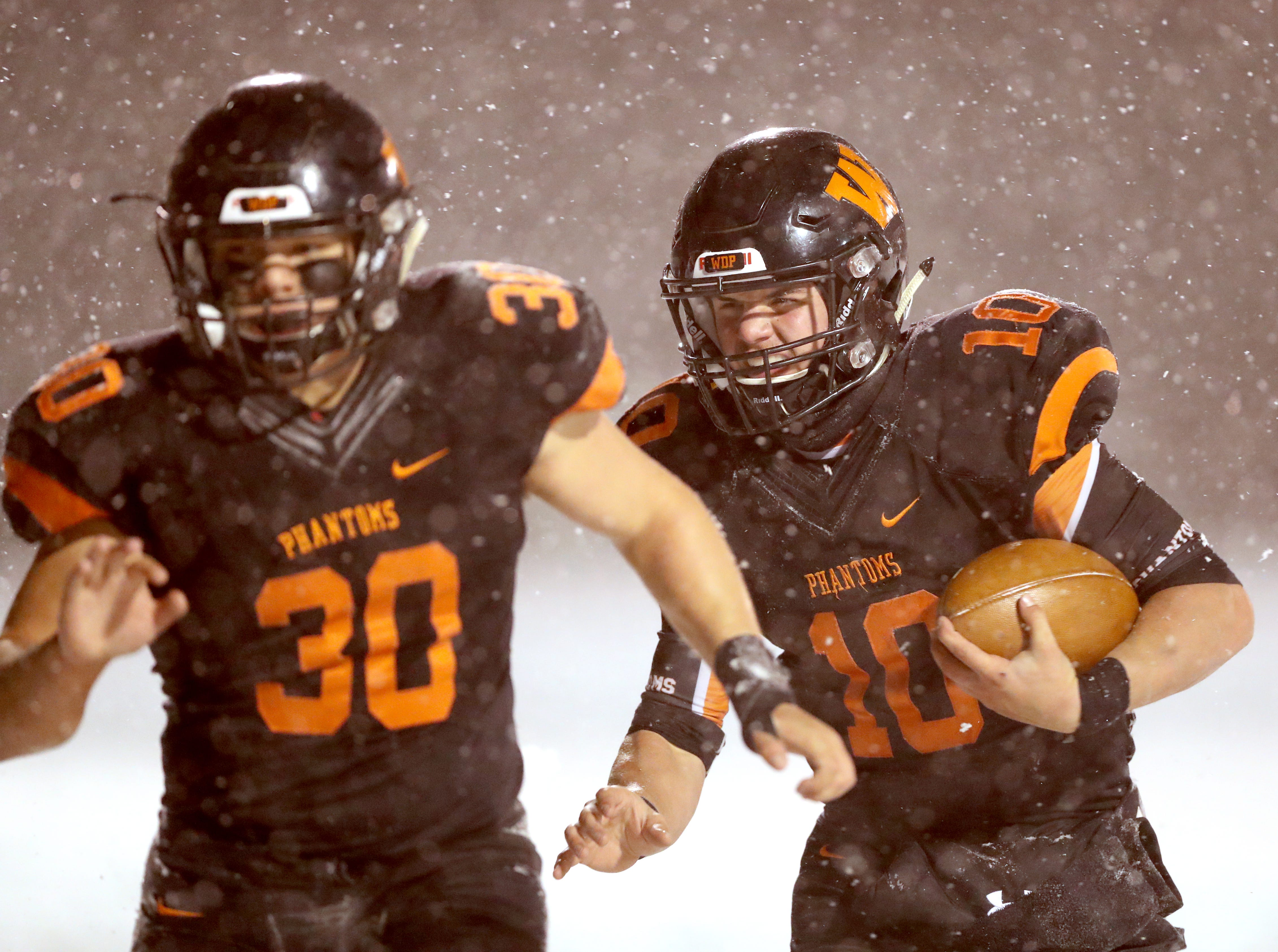 West De Pere's Josh Blount follows the block of Cody Cavil for a touchdown against Rice Lake in the Division 3 Level 4  WIAA playoffs Friday, November 9, 2018 at DC Everest in Weston, Wis.