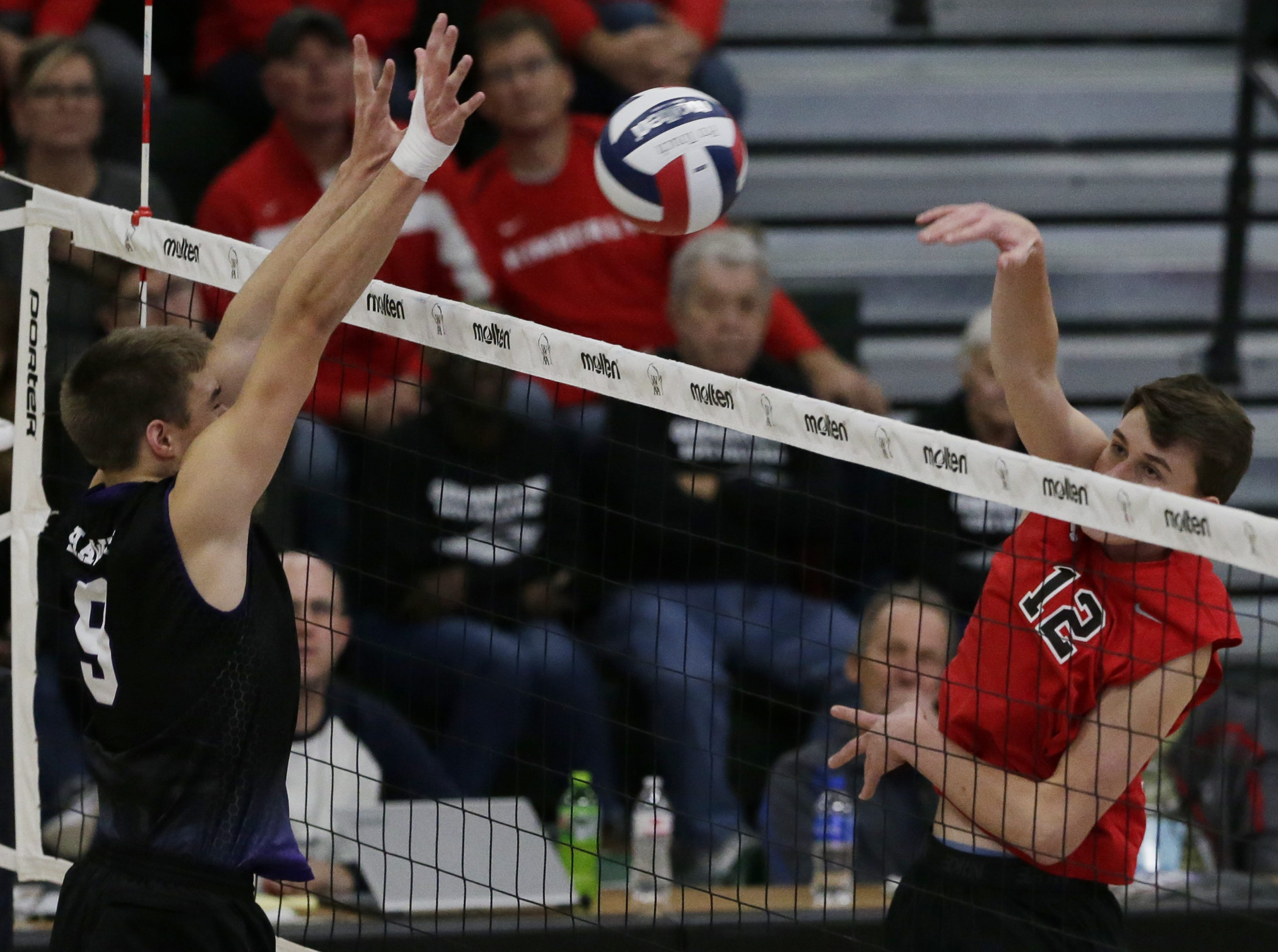 Kimberly's Parker Hietpas hits the ball while Kenosha Indian Trail's Jackson Antos tries to block.  Kimberly Papermakers played Kenosha Indian Trail Hawks in Division 1 WIAA boys volleyball playoff semi-final, Saturday, November 10, 2018 at Wisconsin Lutheran College in Milwaukee, Wis. Joe Sienkiewicz/USA Today NETWORK-Wisconsin