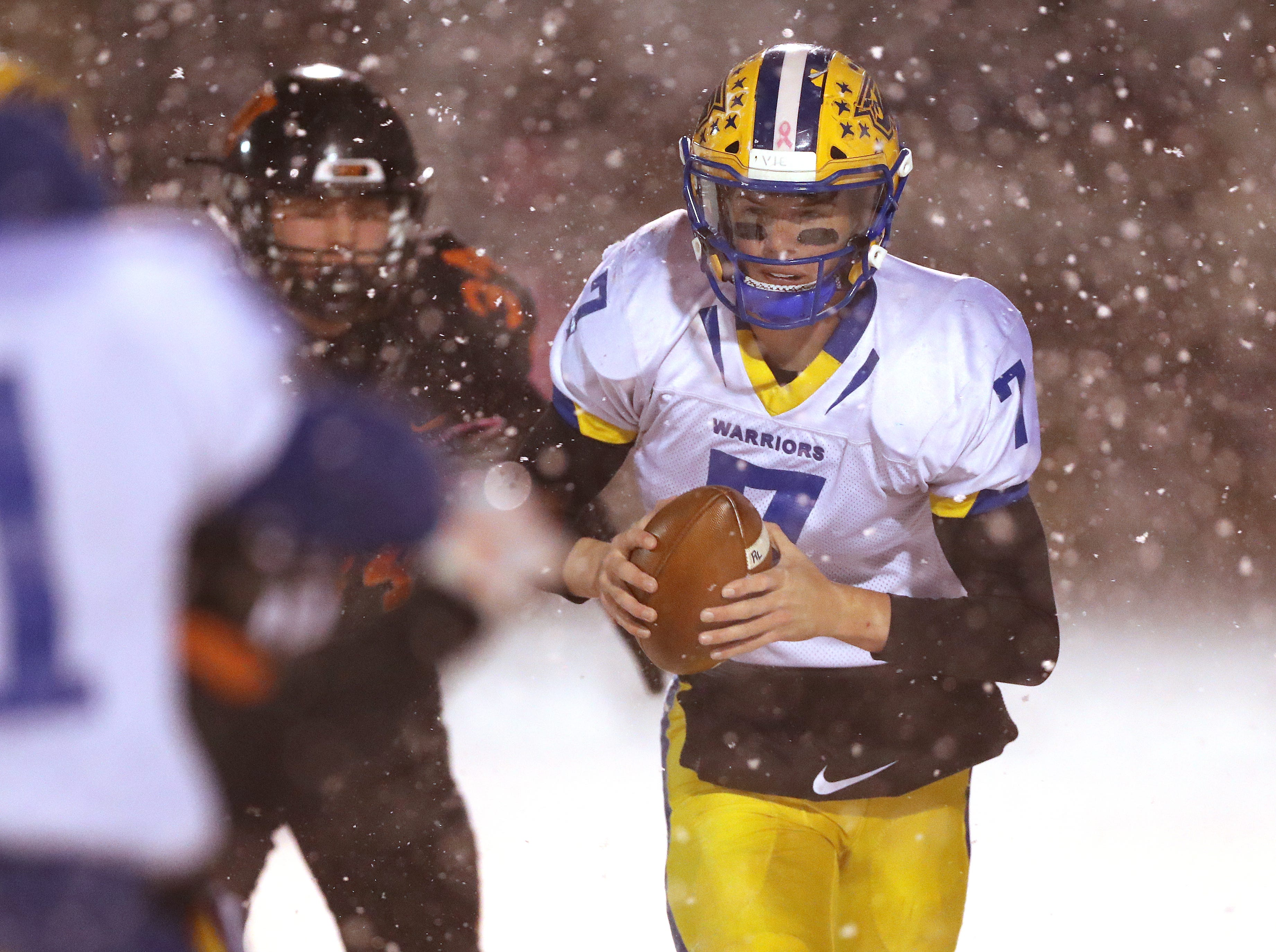 Rice Lake quarterback Peyton Buckley looks for room against West De Pere in the Division 3 Level 4  WIAA playoffs Friday, November 9, 2018 at DC Everest in Weston, Wis.