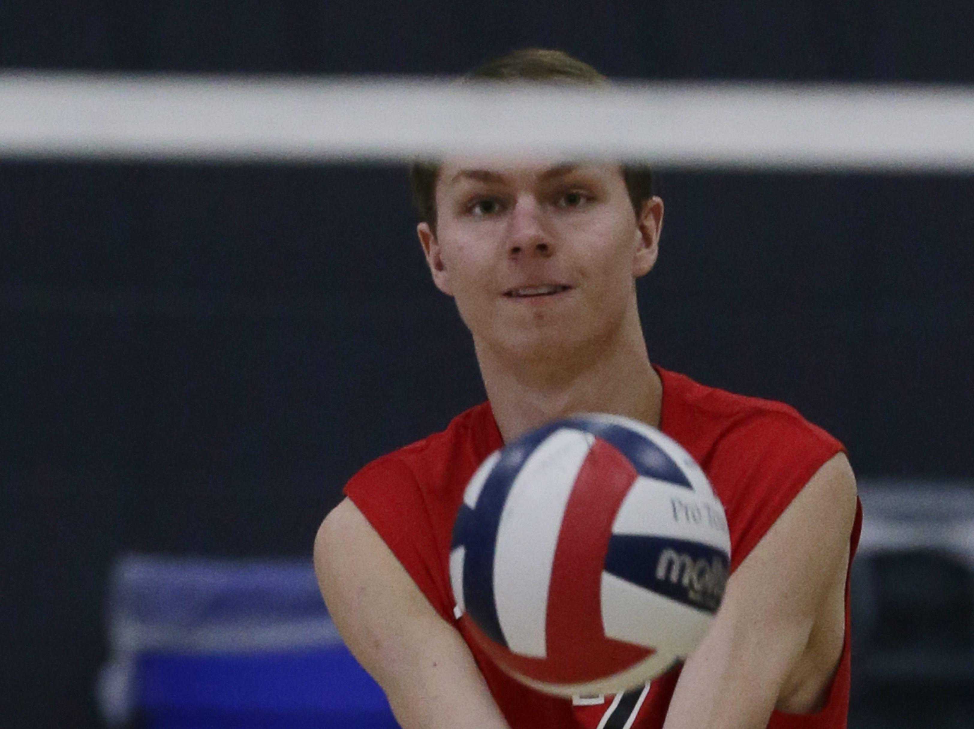 Kimberly's Jacob Schiessl bumps up the ball during their game.  Kimberly Papermakers played Kenosha Indian Trail Hawks in Division 1 WIAA boys volleyball playoff semi-final, Saturday, November 10, 2018 at Wisconsin Lutheran College in Milwaukee, Wis. Joe Sienkiewicz/USA Today NETWORK-Wisconsin