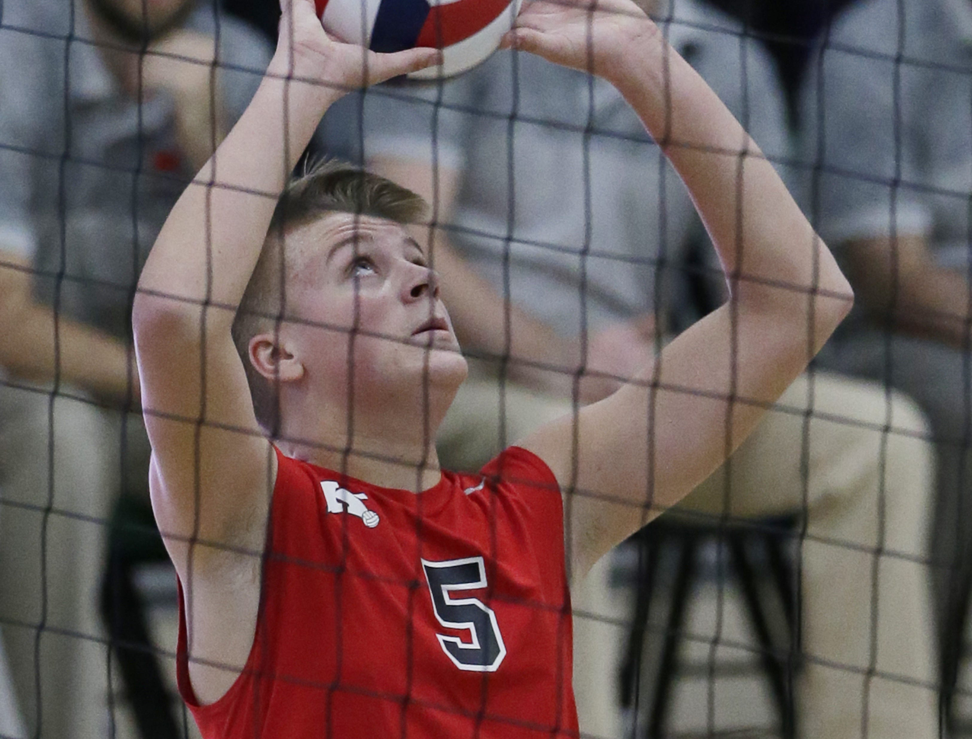 Kimberly's Chase Robinson sets the ball at the net.  Kimberly Papermakers played Kenosha Indian Trail Hawks in Division 1 WIAA boys volleyball playoff semi-final, Saturday, November 10, 2018 at Wisconsin Lutheran College in Milwaukee, Wis. Joe Sienkiewicz/USA Today NETWORK-Wisconsin