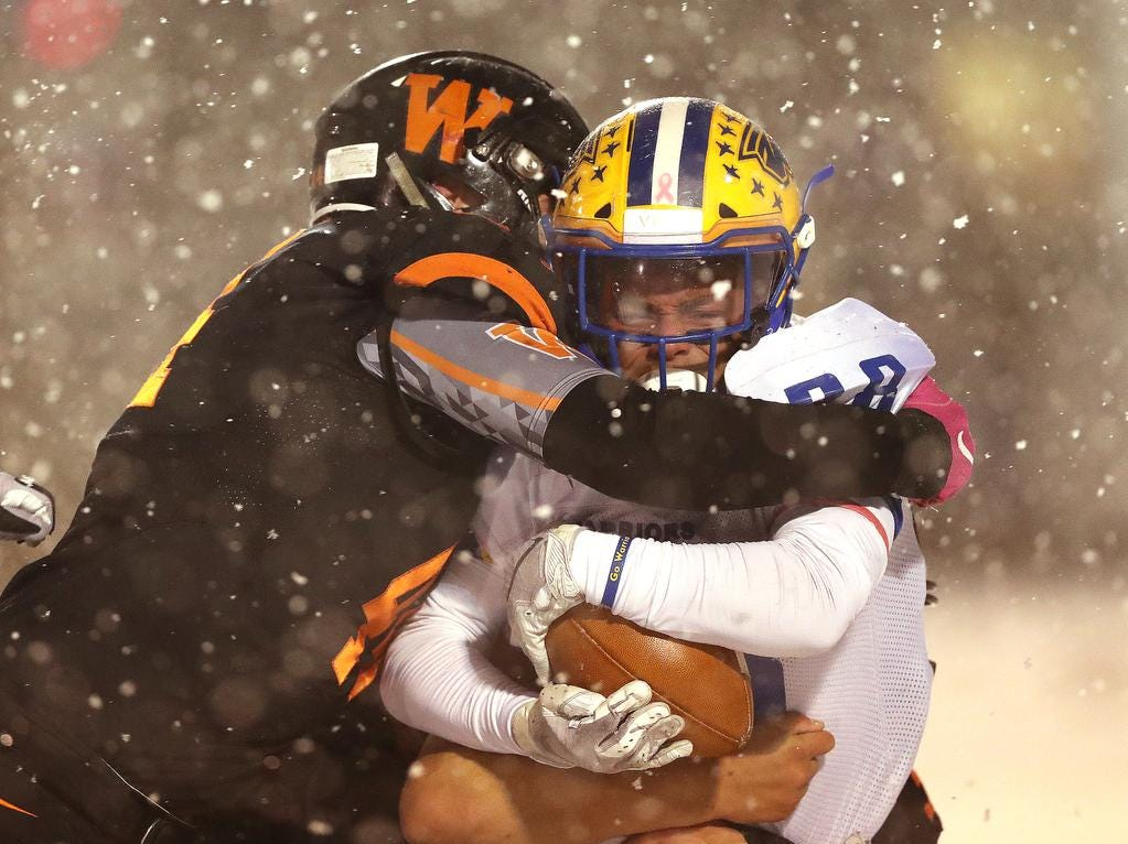 West De Pere's Jake Karchinski tackles Rice Lake back Torien Hubbard in the Division 3 Level 4  WIAA playoffs Friday, November 9, 2018 at DC Everest in Weston, Wis.
