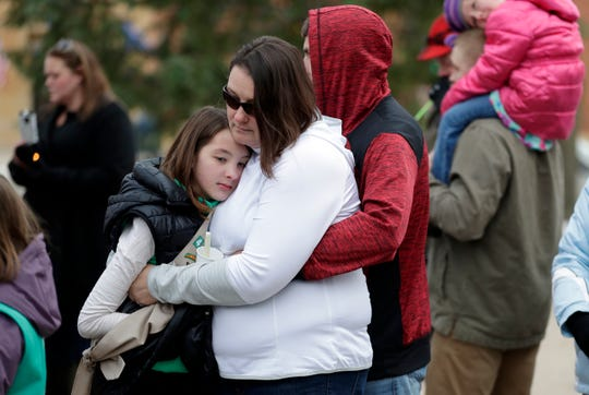 Green Bay-area Girl Scouts and supporters gathered Nov. 10, 2018 outside the Brown County Courthouse to hold a vigil for the adult chaperone and three Girl Scouts who were hit by a vehicle and killed in western Wisconsin while picking up garbage alone a highway.