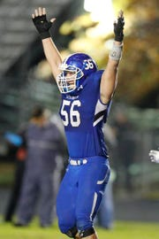 Woodmont's Jake Fernicola (56) celebrates a touchdown late in the first half Friday, November 9, 2018 during the first round of the Class AAAAA football playoffs at Whitt Memorial Field.