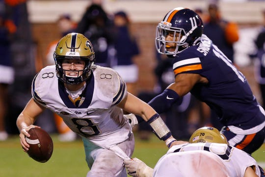 Nov 2, 2018; Charlottesville, VA, USA; Pittsburgh Panthers quarterback Kenny Pickett (8) scrambles with the ball past Virginia Cavaliers linebacker Charles Snowden (11) in the third quarter at Scott Stadium. Mandatory Credit: Geoff Burke-USA TODAY Sports