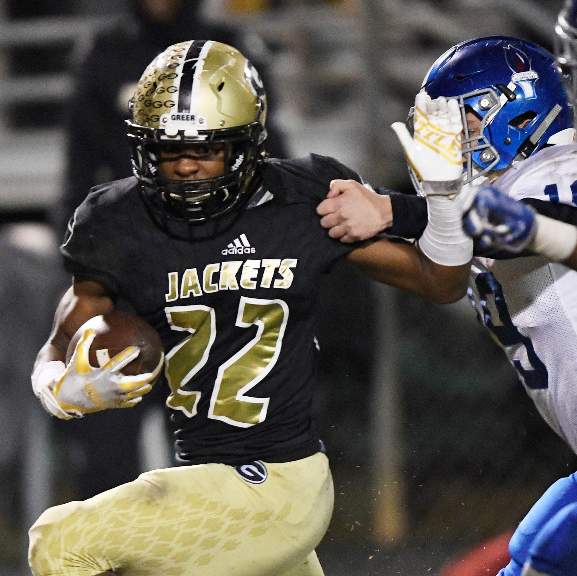 GreerÕs Dre Williams (22) pulls away from Pickens' Collin Hinkle (19) in the first round of the class AAAA playoffs Friday, November 9, 2018 at Greer's Dooley Field.