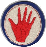 "A ""Red Hand"" patch representing Cpl. Freddie Stowers' 371st Infantry Regiment, which trained at fort Jackson and fought in France."