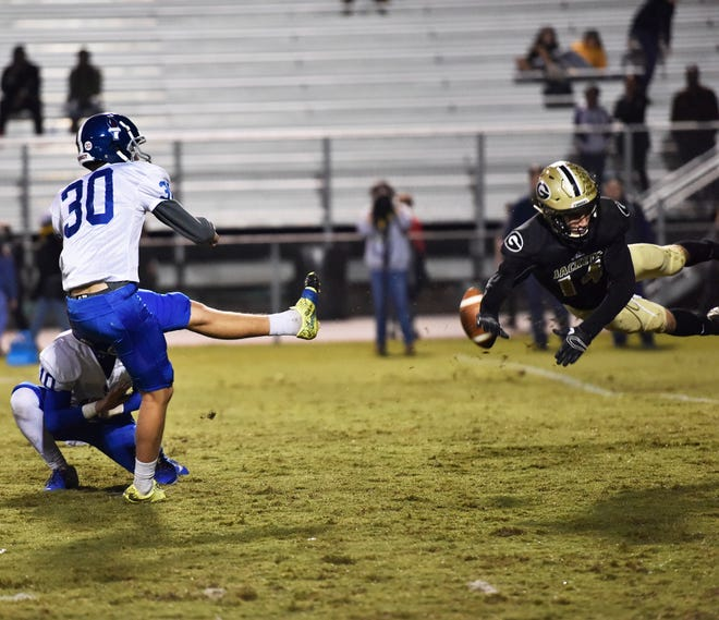 GreerÕs Ethan Alexander (14) blocks a field goal attempt by Pickens' Collier Crant (30) in the first round of the class AAAA playoffs Friday, November 9, 2018 at Greer's Dooley Field.