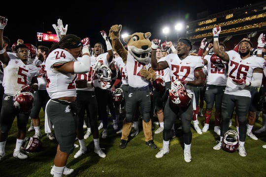 Oct 27, 2018; Stanford, CA, USA; Washington State Cougars mascot Butch T. Cougar celebrates with players after defeating the Stanford Cardinal at Stanford Stadium. Mandatory Credit: Stan Szeto-USA TODAY Sports