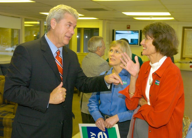 State senator Tommy Moore (left)), the Democratic Gubernatorial nominee,  talks with former congresswoman Liz Patterson (red jacket) after  a campaign appearance at Greenville-Spartanburg Airport Wednesday, Oct 11, 2006.