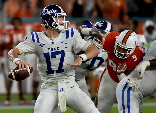 Nov 3, 2018; Miami Gardens, FL, USA; Duke Blue Devils quarterback Daniel Jones (17) throws a pass against the Miami Hurricanes during the first half at Hard Rock Stadium. Mandatory Credit: Steve Mitchell-USA TODAY Sports