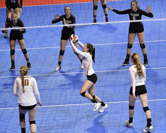 Kolby Pimperton of Belt sets during the Class C undefeated semifinal against Simms at the All-Class State Volleyball Tournament at the Brick Breeden Fieldhouse in Bozeman Friday.