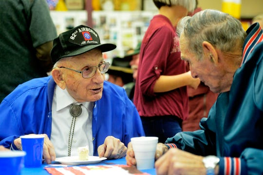 Bud Olson, left, a veteran of the Airborne division of the U.S. Army, talks with Air Force veteran Bill Leys on Friday afternoon after Choteau Elementary School's Veterans Day program.
