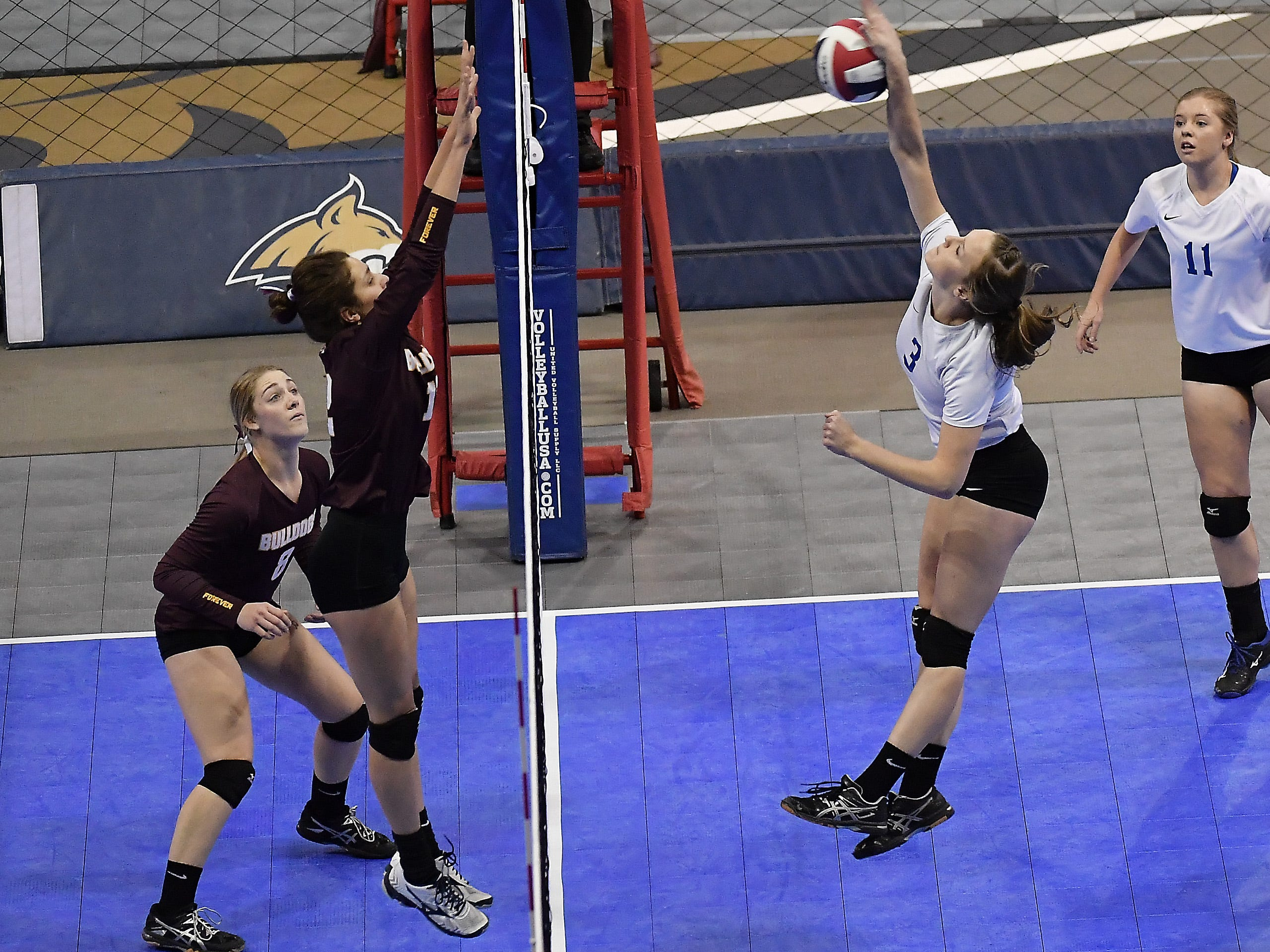 Fairfield's Chesney Rogers, right, attacks as Choteau's Ellie Lee defends at the All-Class State Volleyball Tournament at the Brick Breeden Fieldhouse in Bozeman Friday.