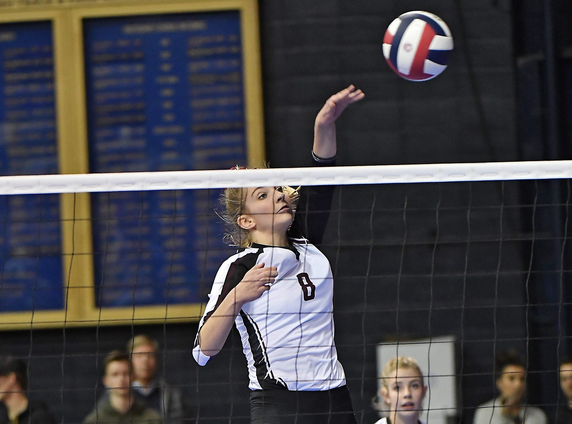 Manhattan Christian's Kierstin Van Kirk attempts a kill during a match with Tri-Cities at the All-Class State Volleyball Tournament at the Brick Breeden Fieldhouse in Bozeman Friday.