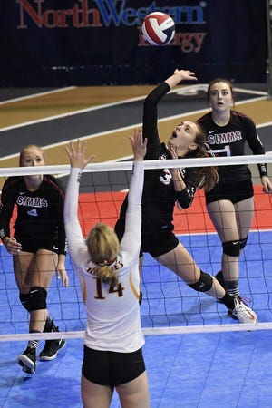 Madison Wiegand of Simms goes for the spike in the Class C undefeated semifinal against Belt at the All-Class State Volleyball Tournament at the Brick Breeden Fieldhouse in Bozeman Friday.