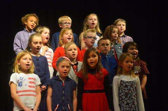 """Choteau Elementary School second graders sing """"My Country Tis of Thee"""" during the Veterans Day program on Friday."""
