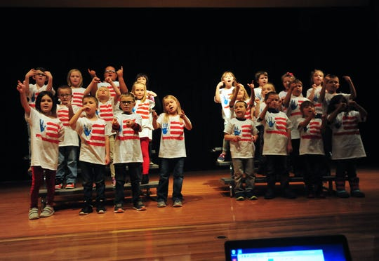 """Choteau Elementary School first graders sing """"This Land is Your Land"""" during the Veterans Day concert on Friday."""