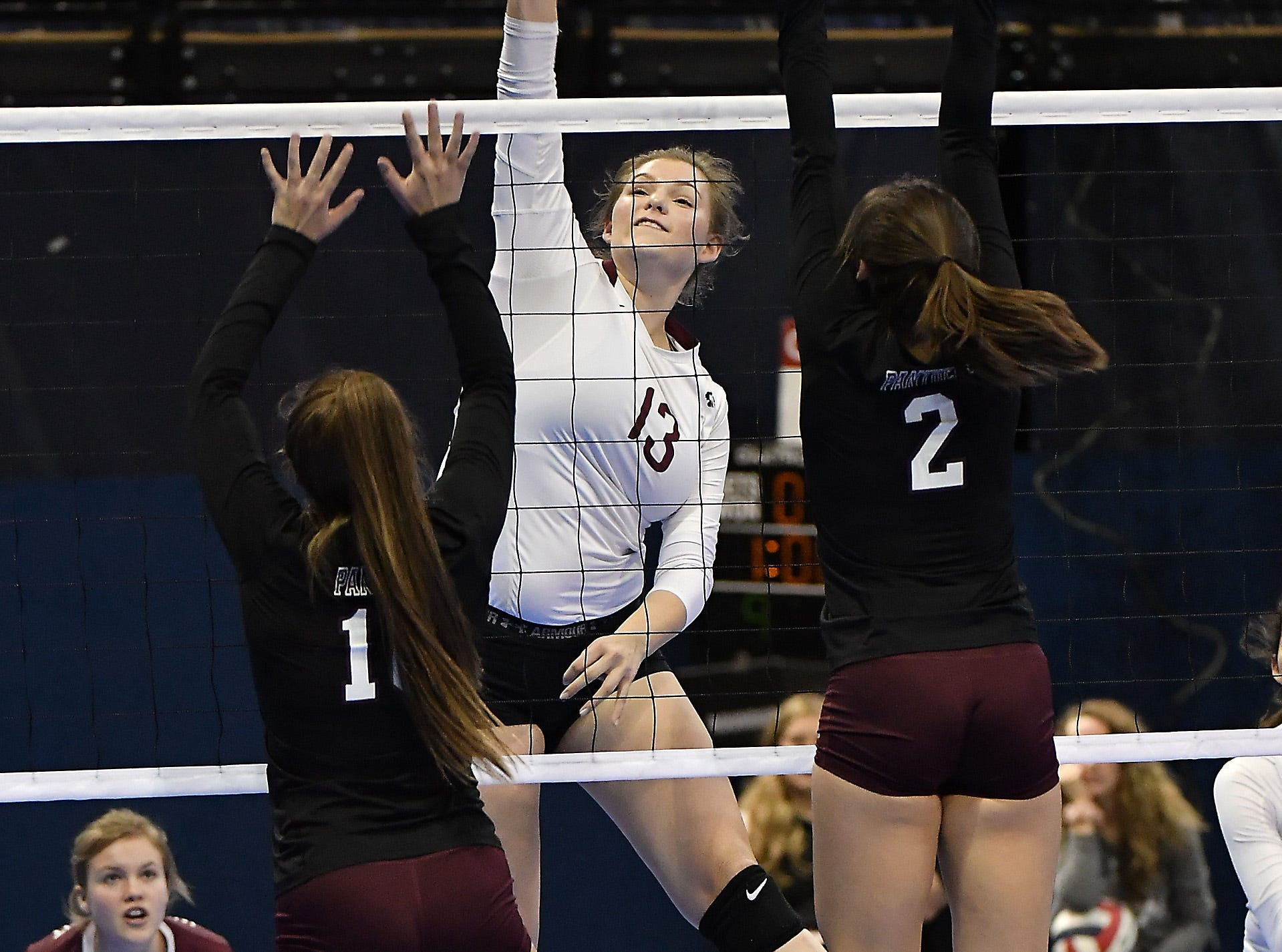 Wolf Point's Imani Bighorn attacks in a match with Roundup at the All-Class State Volleyball Tournament at the Brick Breeden Fieldhouse in Bozeman Friday.