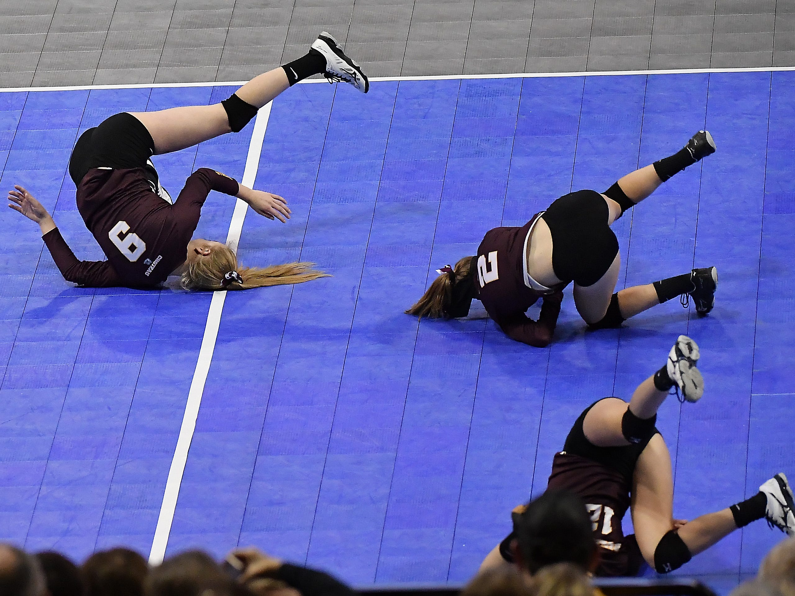 Choteau rolls around in celebration of a point against Fairfield at the All-Class State Volleyball Tournament at the Brick Breeden Fieldhouse in Bozeman Friday.