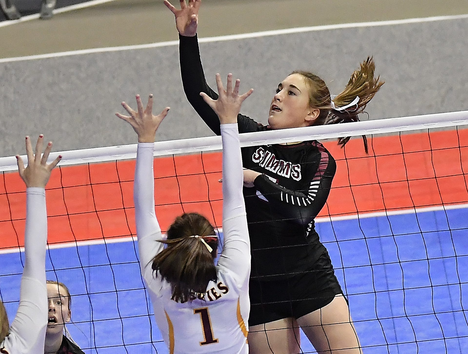 Janessa Willekes of Simms tips the ball in the Class C undefeated semifinal against Belt at the All-Class State Volleyball Tournament at the Brick Breeden Fieldhouse in Bozeman Friday.