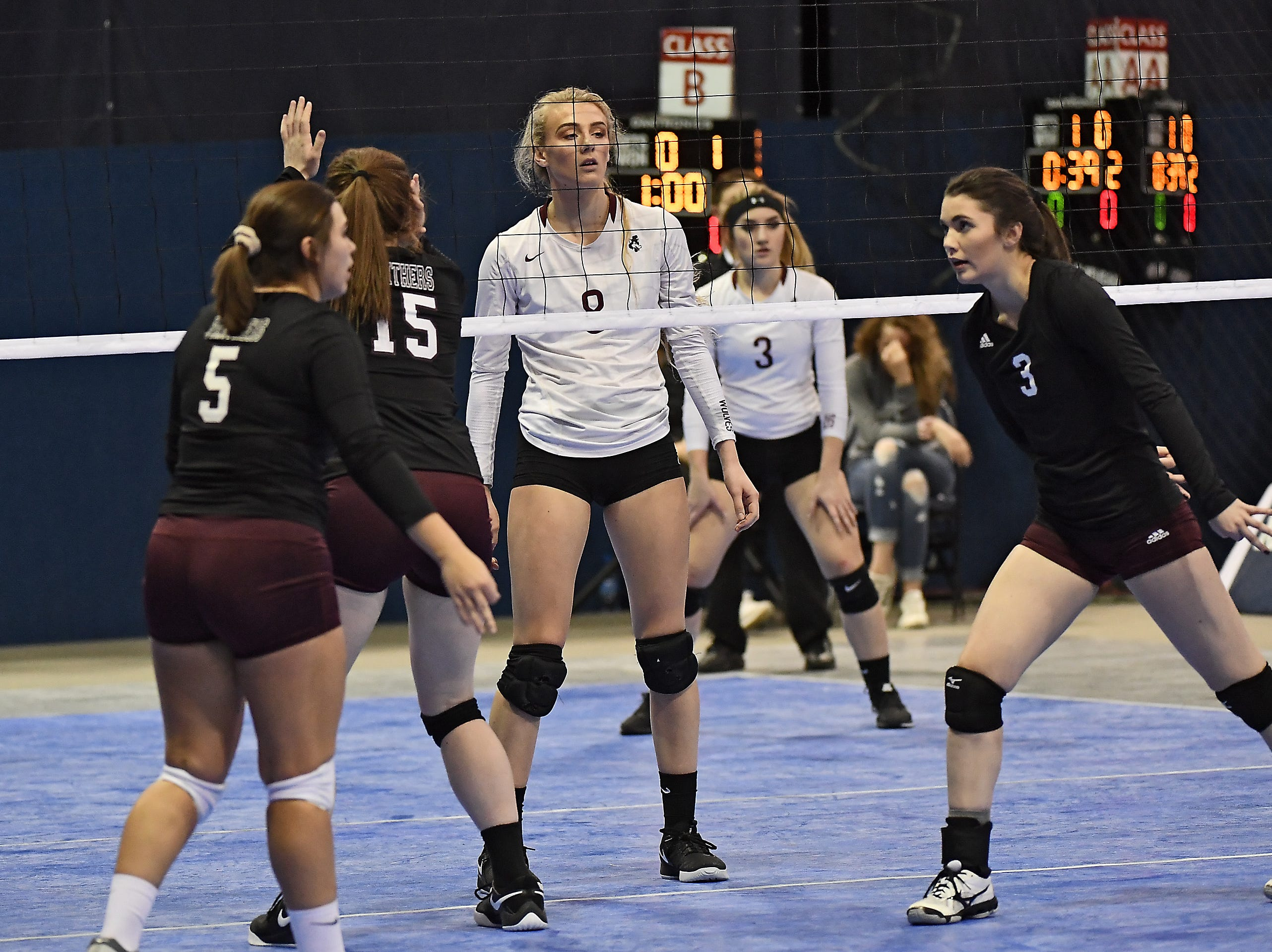 Abby Juve of Wolf Point roams the net in a match with Roundup at the All-Class State Volleyball Tournament at the Brick Breeden Fieldhouse in Bozeman Friday.