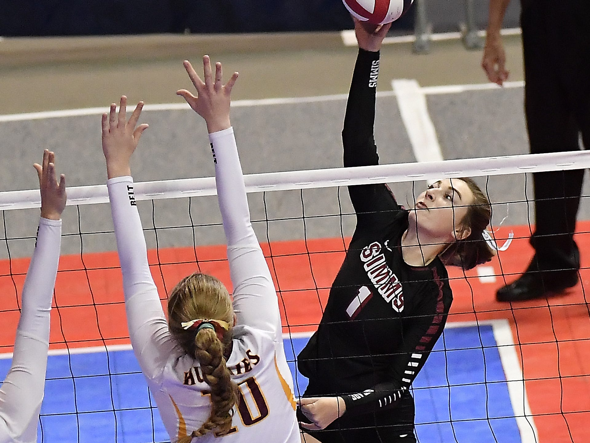 Simms' Taylor Jones looks for the kill in the Class C undefeated semifinal against Belt at the All-Class State Volleyball Tournament at the Brick Breeden Fieldhouse in Bozeman Friday.