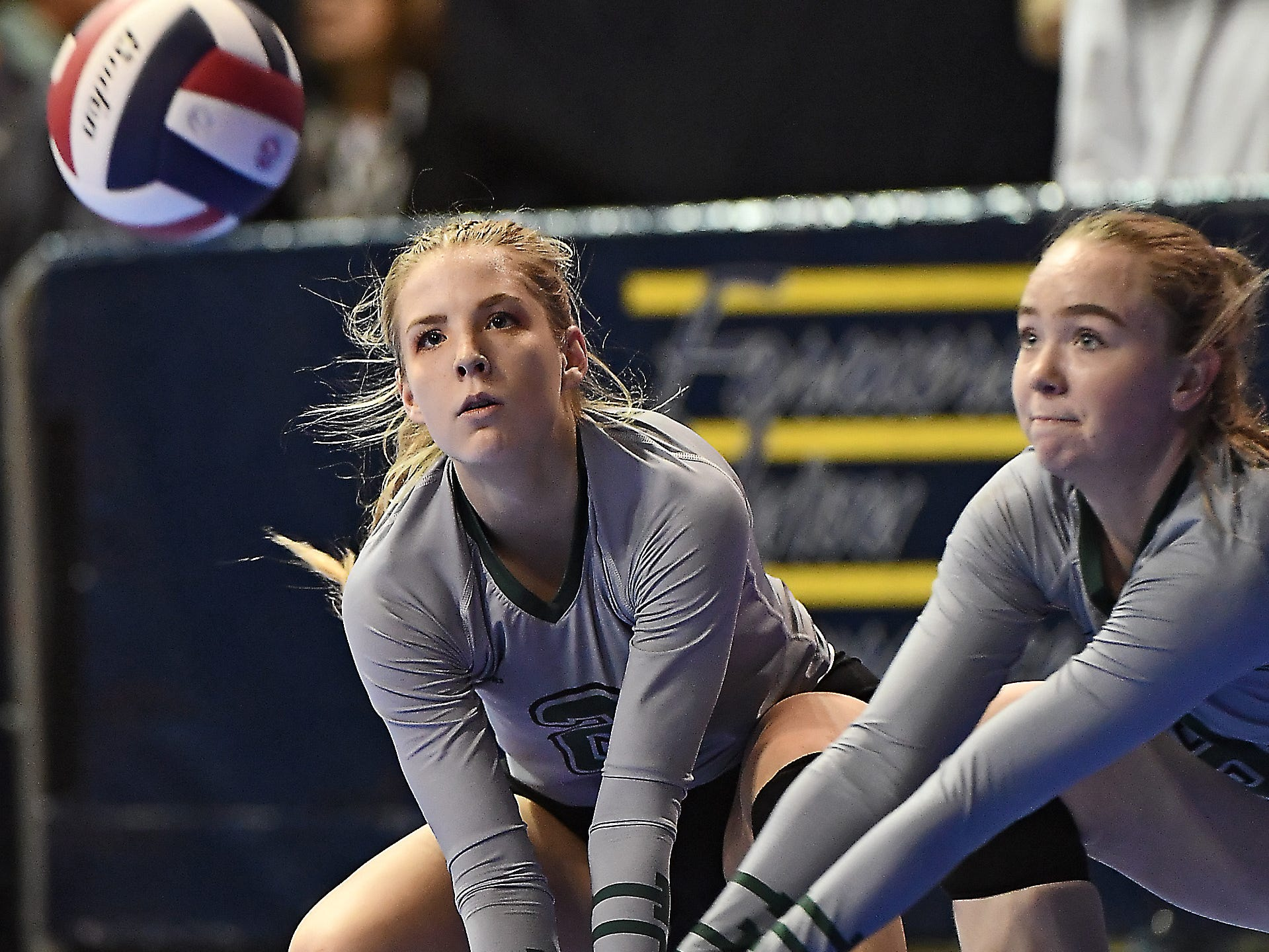 Tri-Cities' Chloe Derks, left, and Brianna Bergum look to make a play on the ball in a match with Manhattan Christian at the All-Class State Volleyball Tournament at the Brick Breeden Fieldhouse in Bozeman Friday.