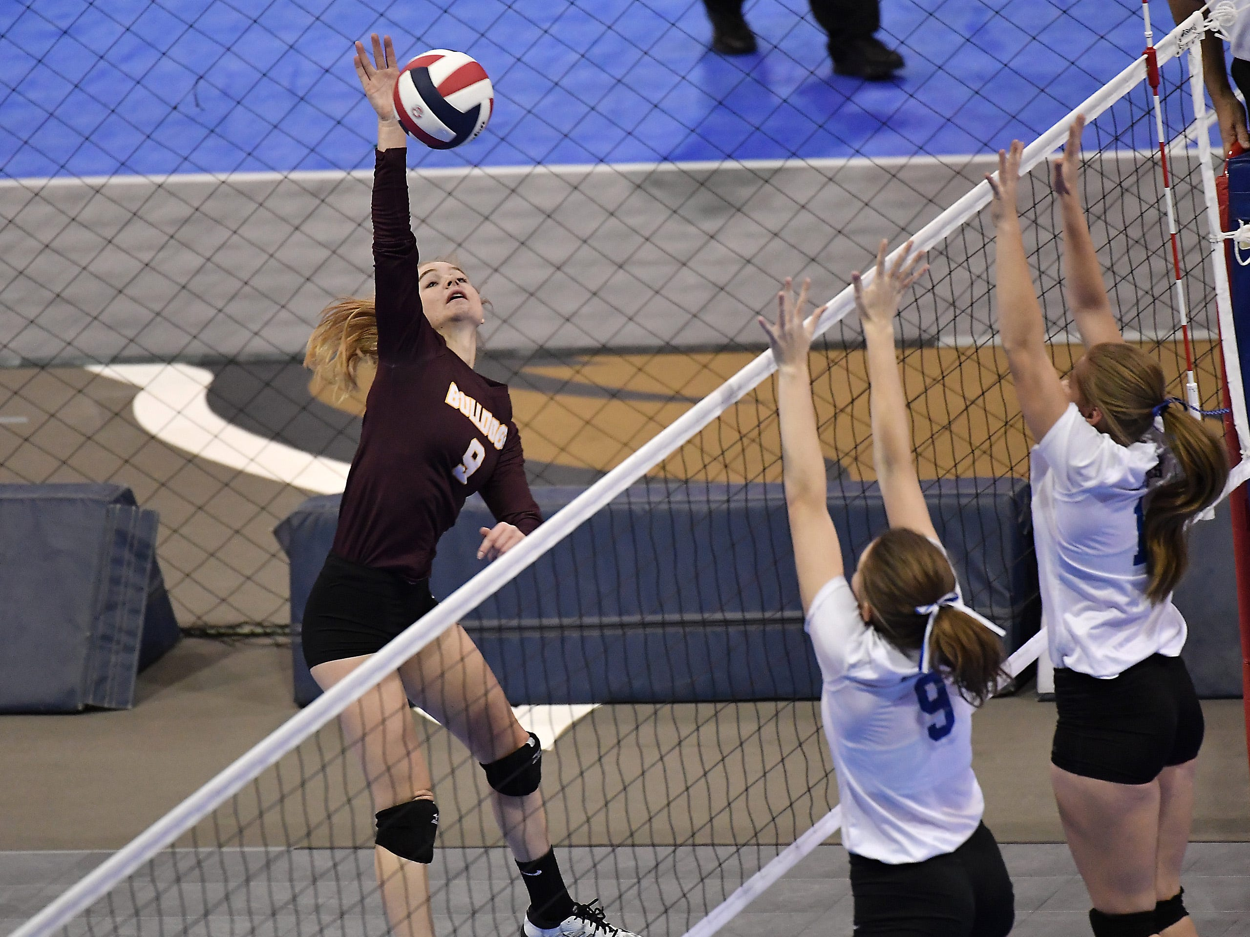 Nicole Krone of Choteau (9) spikes the ball in a match against Fairfield at the All-Class State Volleyball Tournament at the Brick Breeden Fieldhouse in Bozeman Friday.