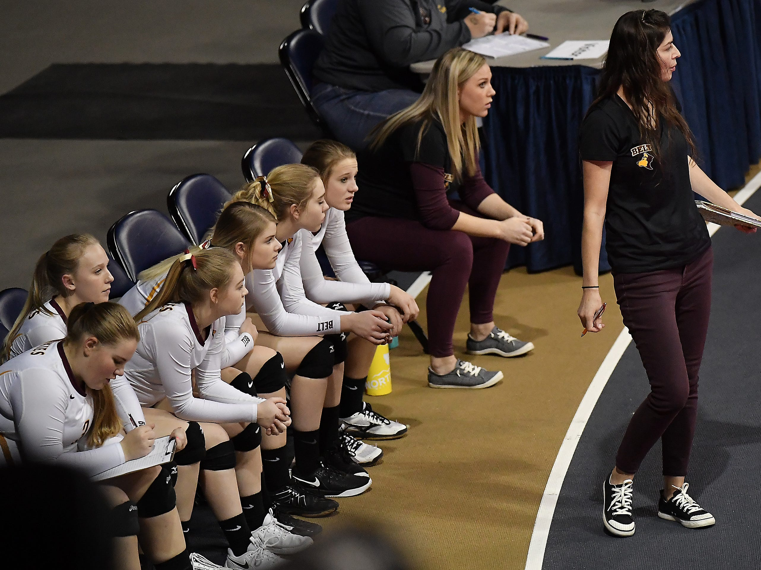 Belt head coach Christine Gondeiro and the Huskies' bench look on during the Class C undefeated semifinal at the All-Class State Volleyball Tournament at the Brick Breeden Fieldhouse in Bozeman Friday.