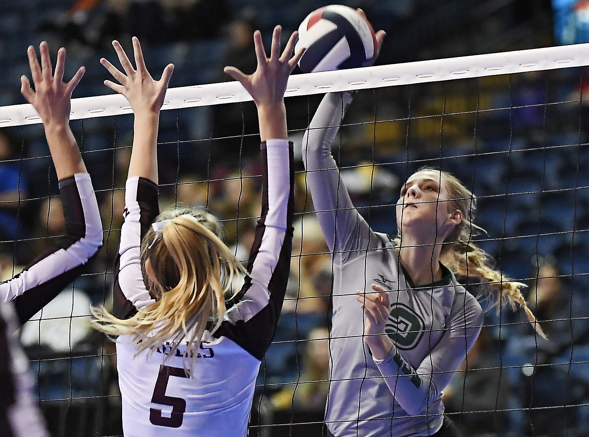 Tri-Cities' Chloe Derks on the attack in a match with Manhattan Christian at the All-Class State Volleyball Tournament at the Brick Breeden Fieldhouse in Bozeman Friday.